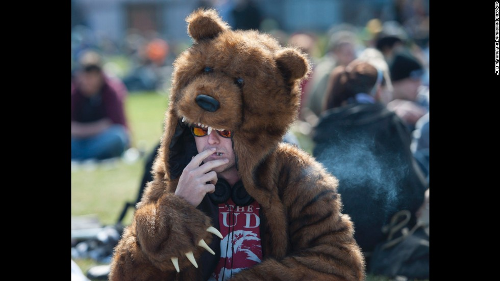 "A man in a bear costume smokes a joint at the Fill the Hill marijuana rally on Parliament Hill in Ottawa on Sunday, April 20. 420 is a once clandestine term used in pot culture to refer to marijuana. <a href=""http://www.cnn.com/2014/04/20/us/denver-420-weekend/"">Though the date has long been observed in Colorado</a>, this is the first celebration since recreational sales of marijuana became legal in the state on New Year's Day."
