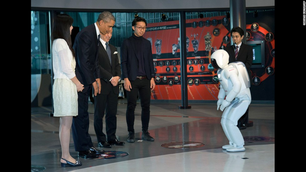"President Barack Obama and ASIMO bow to each other during a youth science event at the National Museum of Emerging Science and Innovation, or the Miraikan, in Tokyo, on Thursday, April 24. The robot performed a series of exercises including one with a soccer ball. The President told an audience of some 30 students that ""we saw some truly amazing robots -- although I have to say the<a href=""http://politicalticker.blogs.cnn.com/2014/04/24/obama-japanese-robots-a-little-scary/?hpt=hp_t3""> robots were a little scary.</a> They were too lifelike. They were amazing."""