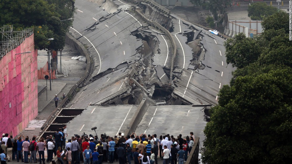 People gather to observe the Perimetral overpass after its partial demolition in Rio de Janeiro on Sunday, April 20. The project is part of the city's redevelopment ahead of the 2016 Olympic Games.