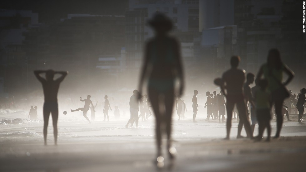 Mist shrouds a man playing altinha, a soccer spinoff played on the beach, on Rio de Janeiro's Ipanema Beach on Monday, April 21.