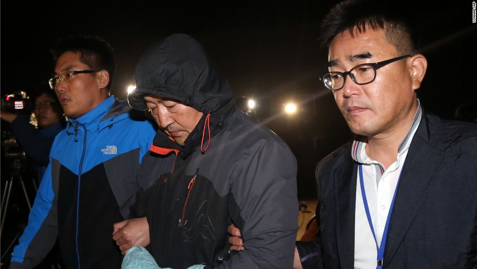 "Lee Joon-seok, center, the captain of the <a href=""http://www.cnn.com/2014/04/15/asia/gallery/south-korea-sinking-ship/index.html"">sunken ferry Sewol</a>, leaves a court that issued his arrest warrant in Mokpo, South Korea, on Saturday, April 19. Lee and some other crew members have been criticized for <a href=""http://www.cnn.com/2014/04/23/world/asia/south-korea-ship-sinking/index.html"">failing to evacuate the sinking ship quickly</a> and for giving orders for passengers to remain where they were. Lee has said he was worried about the cold water, strong currents and lack of rescue vessels."