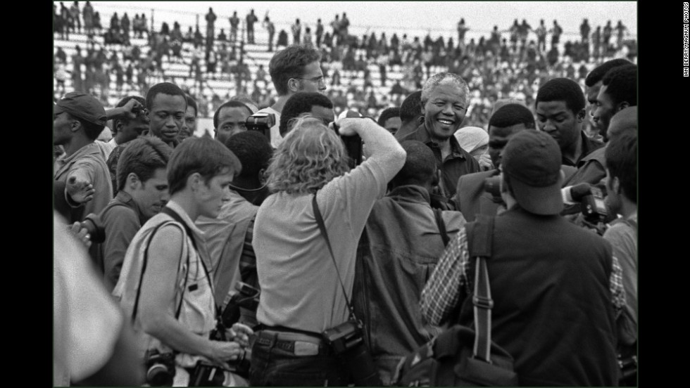 Mandela is mobbed by journalists before an ANC rally.