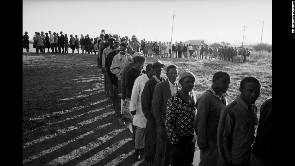 At dawn on election day, a line of South Africans wait to vote.