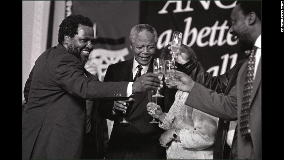 Mandela and ANC leaders drink a toast during the ANC election victory ball.