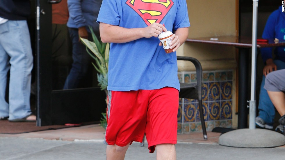 Henry Cavill might want to watch his back; it looks like Adam Sandler is feeling a lot like Superman these days.