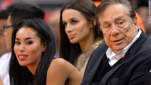 Los Angeles Clippers owner Donald Sterling and V. Stiviano, left, watch a basketball game last year.