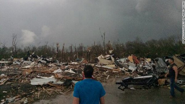 This photo provided by James Bryant shows tornado damage, Sunday, April 27, 2014 in Mayflower, Ark. A powerful storm system rumbled through the central and southern United States on Sunday, spawning several tornadoes, including one that killed two people in a small northeastern Oklahoma city and another that carved a path of destruction through several northern suburbs of Little Rock, Ark. (AP Photo/Courtesy of James Bryant) MANDATORY CREDIT
