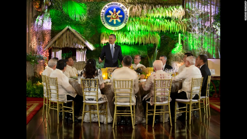 Obama stands to speak as he attends a state dinner at the Malacanang Palace on April 28.