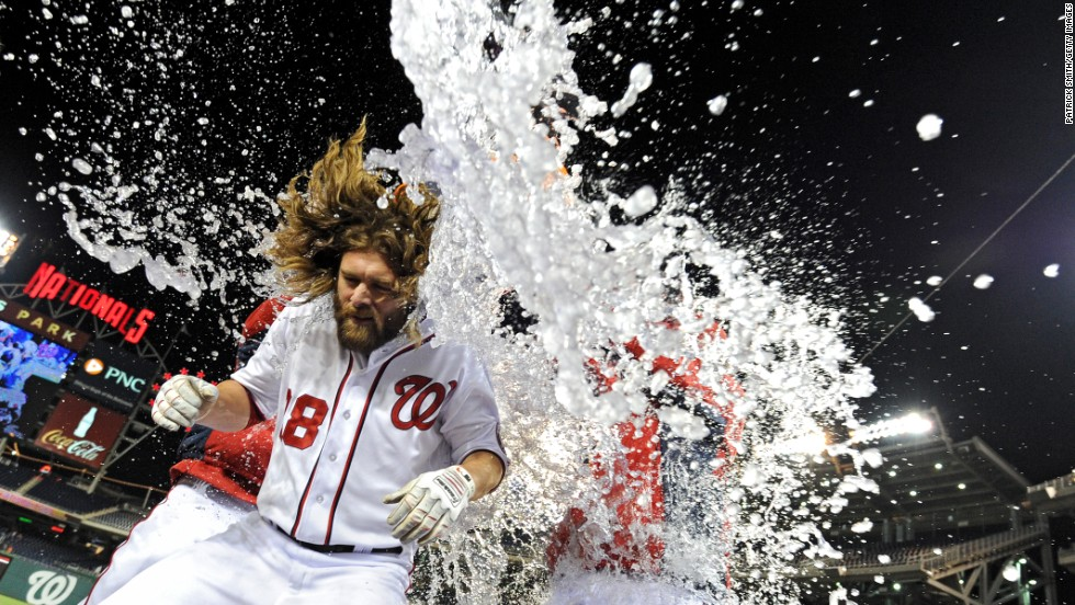 Jayson Werth is doused with water by his teammates after he scored the winning run in the Washington Nationals' ninth-inning comeback versus the Los Angeles Angels of Anaheim on Wednesday, April 23.