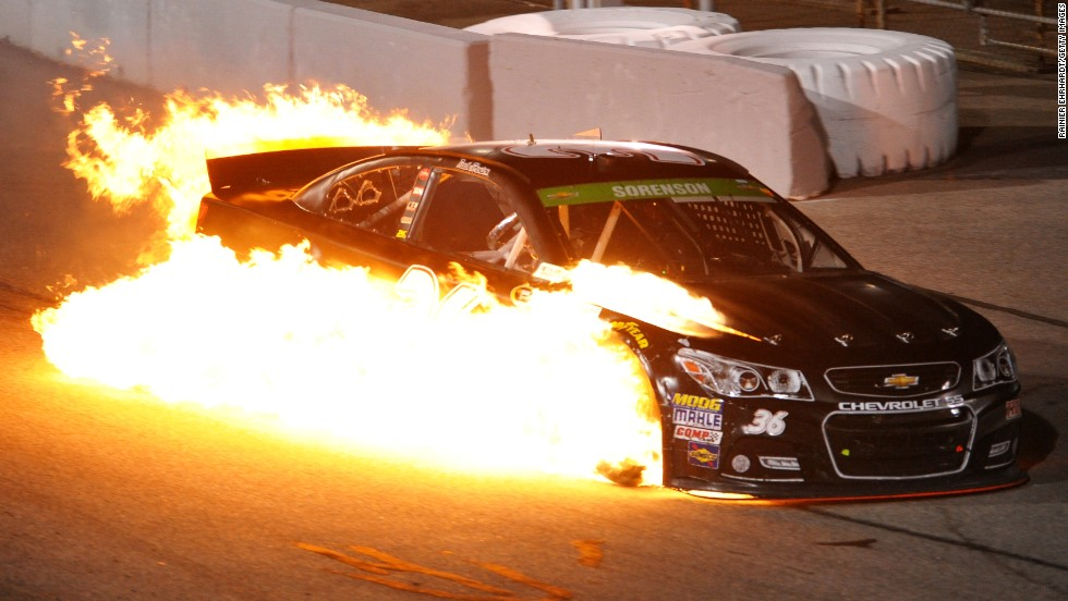 Reed Sorenson's car catches fire on Saturday, April 26, during the NASCAR Sprint Cup race in Richmond, Virginia. Sorenson was OK after being pulled from the car.
