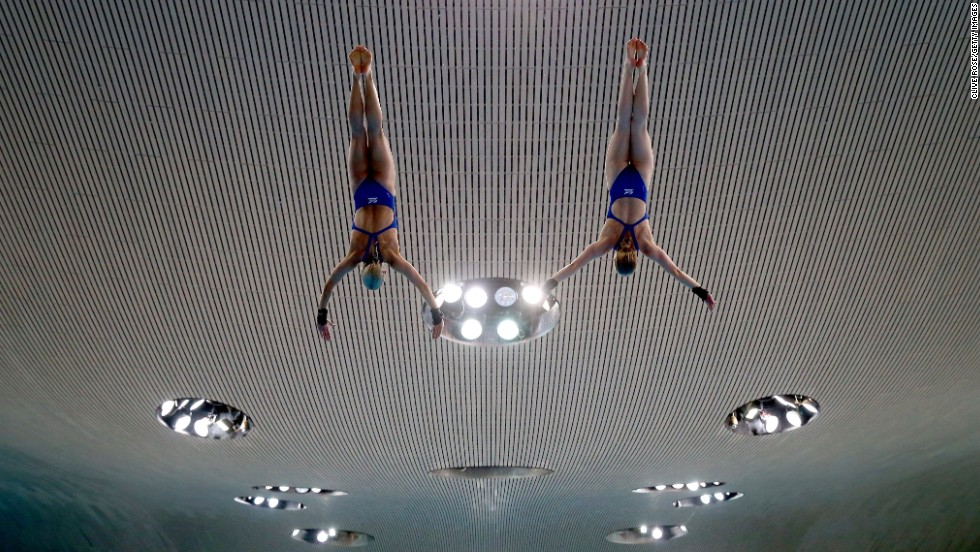 Tonia Couch and Sarah Barrow practice a synchronized dive Friday, April 25, at the FINA/NVC Diving World Series in London. The Brits won silver in the 10-meter platform, losing out to Chen Ruolin and Liu Huixia of China.