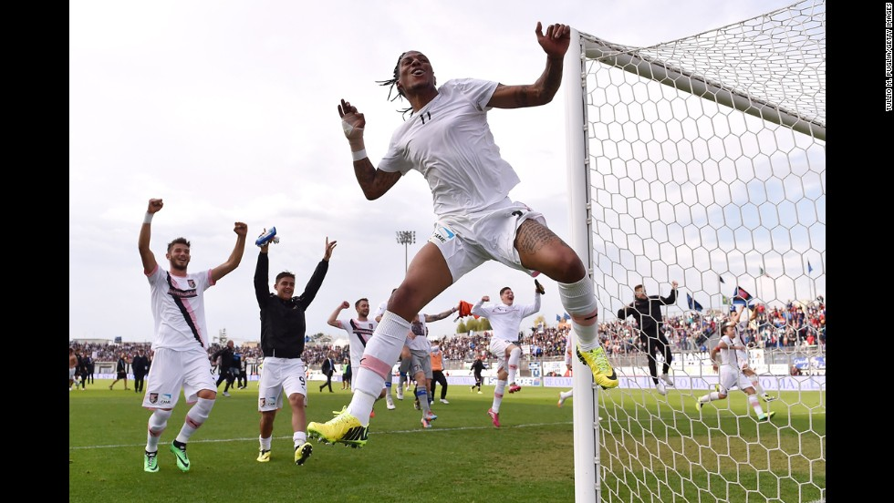 Palermo's Abel Hernandez, foreground, celebrates with his teammates after winning a Serie B match at Latina on Saturday, April 26. Serie B is the second-highest division of Italian soccer.