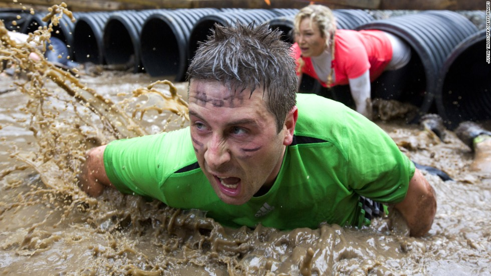 "Participants crawl through tubing during the Tough Mudder endurance race held Saturday, April 26, in Henley-on-Thames, England. <a href=""http://www.cnn.com/2014/04/22/worldsport/gallery/what-a-shot-0422/index.html"">See 25 amazing sports photos from last week</a>"