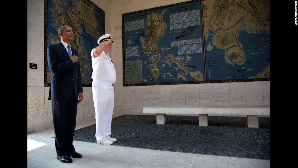 Obama holds his hand over his heart as he participates in a wreath-laying ceremony with Larry Adkison, the superintendent of the Manila American Cemetery and Memorial, at Fort Bonifacio on April 29.