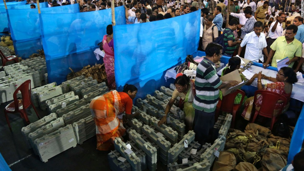 Election officials distribute electronic voting machines and other material to polling officials in Howrah, India, on Tuesday, April 29.