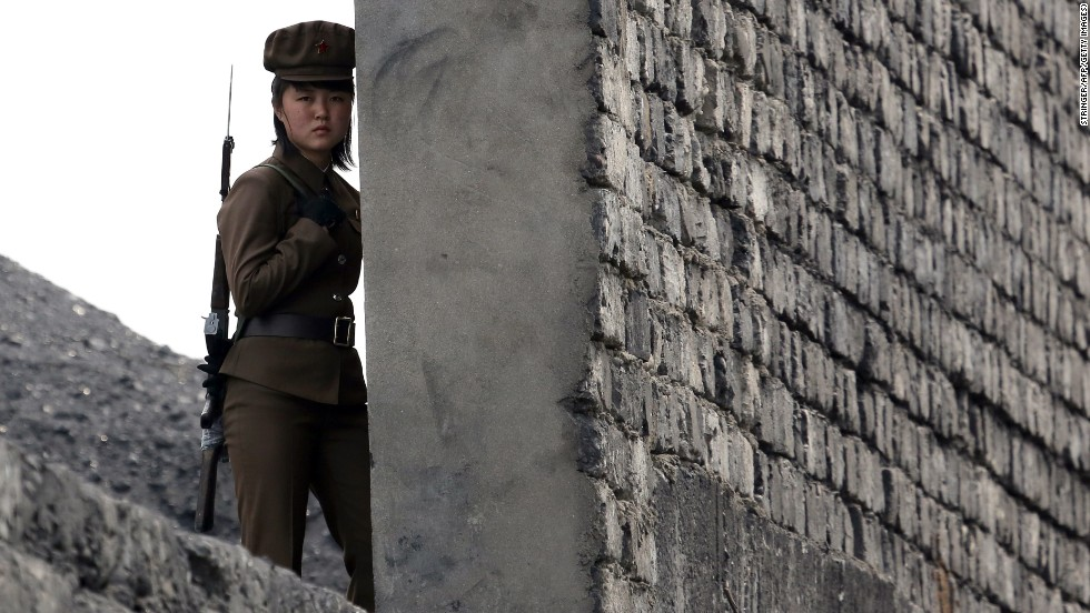 A North Korean soldier patrols the bank of the Yalu River, which separates the North Korean town of Sinuiju from the Chinese border town of Dandong, on Saturday, April 26.
