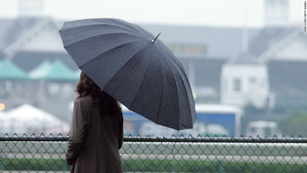 Umbrellas have been a must-have item in the buildup to the Kentucky Derby but forecasters predict improved weather on Saturday.