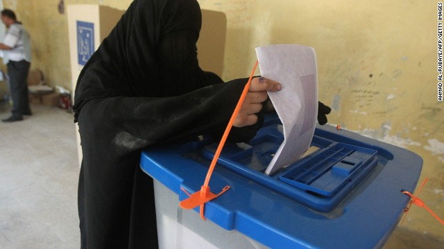 An Iraqi woman casts her vote at a polling station in Baghdad's Sadr City district during the country's general elections on April 30, 2014.
