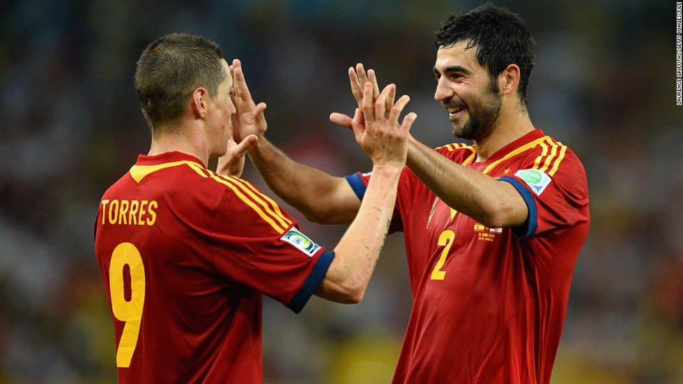 Torres celebrates with teammate Raul Albiol. David Villa also scored a hat-trick, David Silva netted twice and Juan Mata also got on the score sheet.