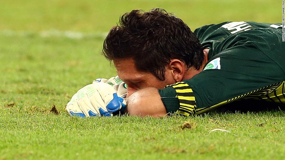 "Tahiti goalkeeper Mickael Roche buries his face in the Maracana turf. ""I hate having goals scored against me, but 10? It really hurts,"" he said."