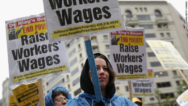 Workers demonstrate for a higher minimum wage on April 29 in Washington.