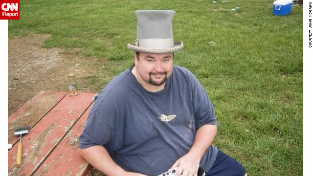 Photographer John McGraw occasionally wears a top hat to the Kentucky Derby.