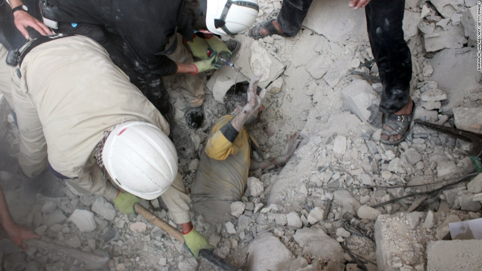 Emergency responders in Aleppo, Syria, rescue a man who was buried under rubble after a reported barrel-bomb attack on Friday, April 25.