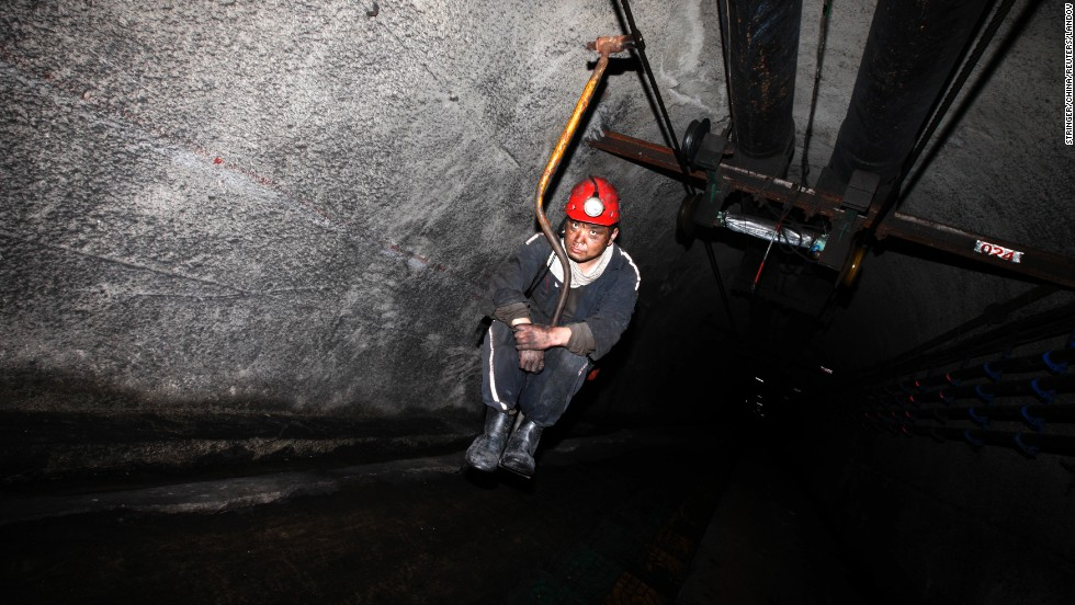 A miner takes an elevator down a coal mine in Huaibei, China, on Saturday, April 26.