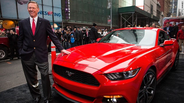 NEW YORK, NY - DECEMBER 05: Alan Mulally, CEO of Ford, poses next to the 2015 Ford Mustang on the set of Good Morning America on December 5, 2013 in New York City. The 2015 model marks the 50th anniversary of the Ford Mustang line. (Photo by Andrew Burton/Getty Images)