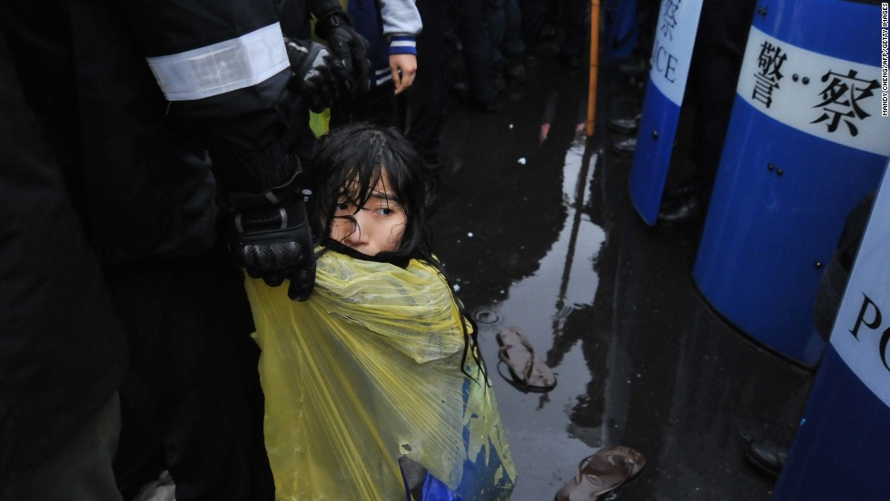 Police remove a protester from outside the Taipei Railway Station during an anti-nuclear demonstration in Taipei, Taiwan, on Monday, April 28. Police used water cannons to dislodge hundreds of activists who had occupied a busy street to protest a nuclear power plant.