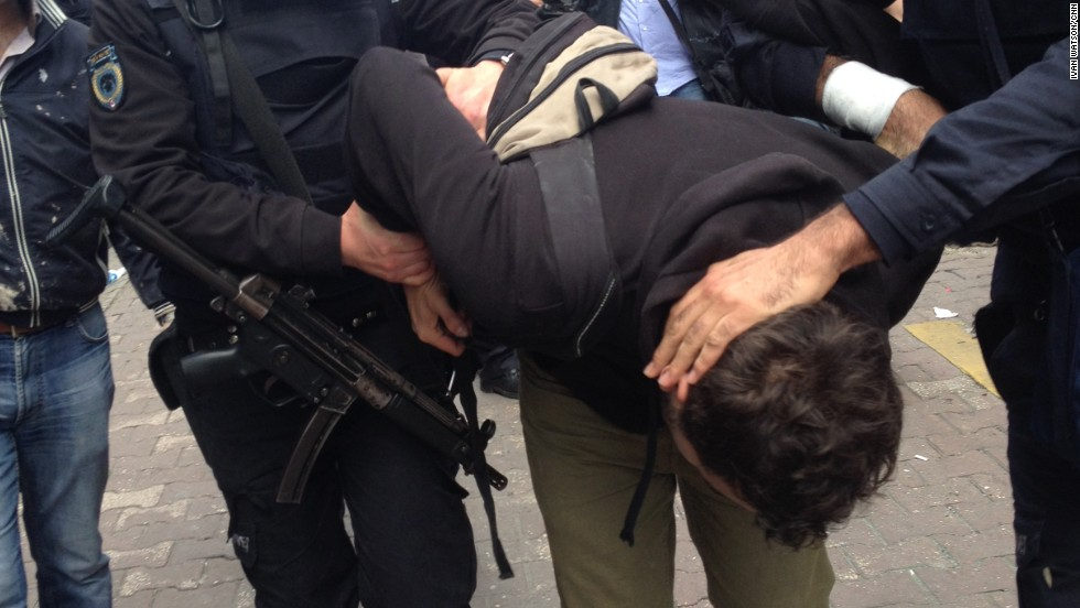 """Another protester is detained by the police. The governor's office justified the protest ban, arguing that May Day rallies would hurt Istanbul's image as a tourist destination,"" he says."