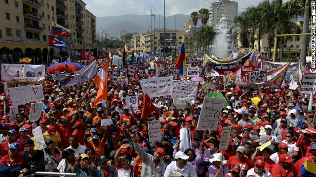 Supporters of Venezuelan President Nicolas Maduro attend a May Day rally in Caracas on May 1, 2014. AFP PHOTO/FEDERICO PARRA (Photo credit should read FEDERICO PARRA/AFP/Getty Images)