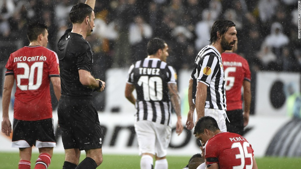 Benfica's Enzo Perez is shown a red card by referee Mark Clattenburg, giving Juve renewed hope with 20 minutes to go.