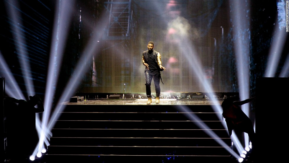 Usher performs.
