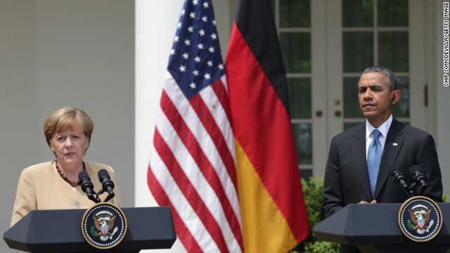 German President Angela Merkel (L) and U.S President Barack Obama address the media in the Rose Garden at the White House on May 2, 2014 in Washington, DC
