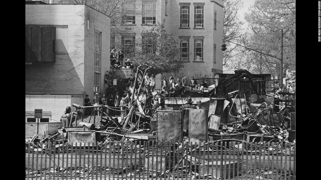 A night of violence in downtown Kent is followed by a student march to the campus ROTC building the next day. Some students try to burn the building down. While the protesters claim they left the building intact and in the hands of campus police when they returned to their dorms, the building is destroyed. It is still not clear who burned it down.