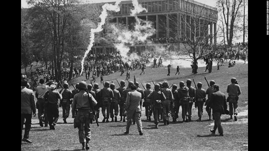 The Ohio National Guard is called in to disperse a rally scheduled for at noon on May 4, 1970. Shortly after the protest began, guardsmen fired tear gas at the students. Some students said they were surprised the guardsmen followed them as they ran away from the tear gas. The guardsmen were clearly armed, but many students later said they believed their weapons were not loaded with actual ammunition.