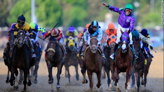 =California Chrom, ridden by Victor Espinoza, crosses the finish line to win the 140th running of the Kentucky Derby at Churchill Downs on May 3 in Louisville, Kentucky.