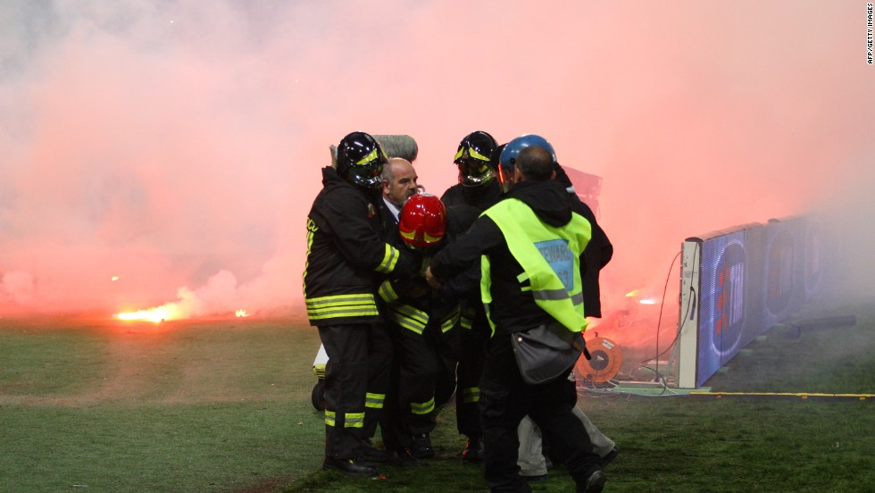 A firefighter is injured by a flare before the Italian Cup Final.