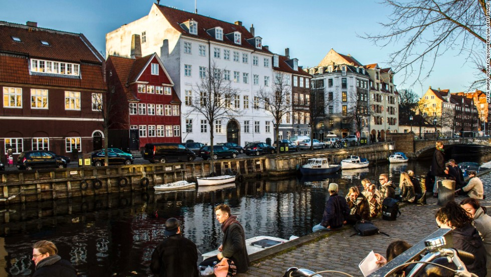 Pedestrians enjoy the weather in the Christians Havn district of Copenhagen, <strong>Denmark</strong>. The Danes enjoy the best work-life balance of all OECD countries, and also rank at the top in social connections. Denmark comes in at number four on the OECD list.<br />