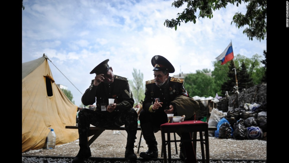 Pro-Russian Cossacks sit outside the regional administration building in Donetsk on May 5.