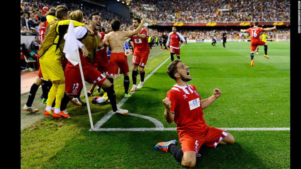 Daniel Carrico, bottom, and his Sevilla teammates celebrate a goal Thursday, May 1, that would clinch their spot in the final of the Europa League soccer competition. Sevilla lost the match to Valencia 3-1, but Stephane Mbia's late goal in stoppage time meant Sevilla would advance on away goals. Sevilla had already beaten Valencia 2-0 in the first leg of the semifinal.
