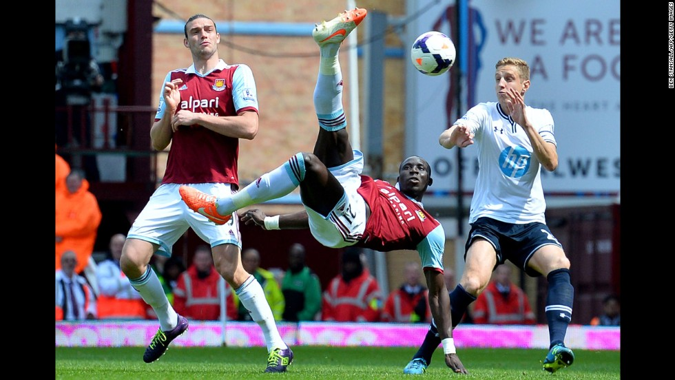 West Ham United midfielder Mohamed Diame attempts an overhead kick during the English Premier League match against Tottenham Hotspur on Saturday, May 3, in London. West Ham won the home match 2-0 to ensure they would stay clear of the league's relegation zone this season.