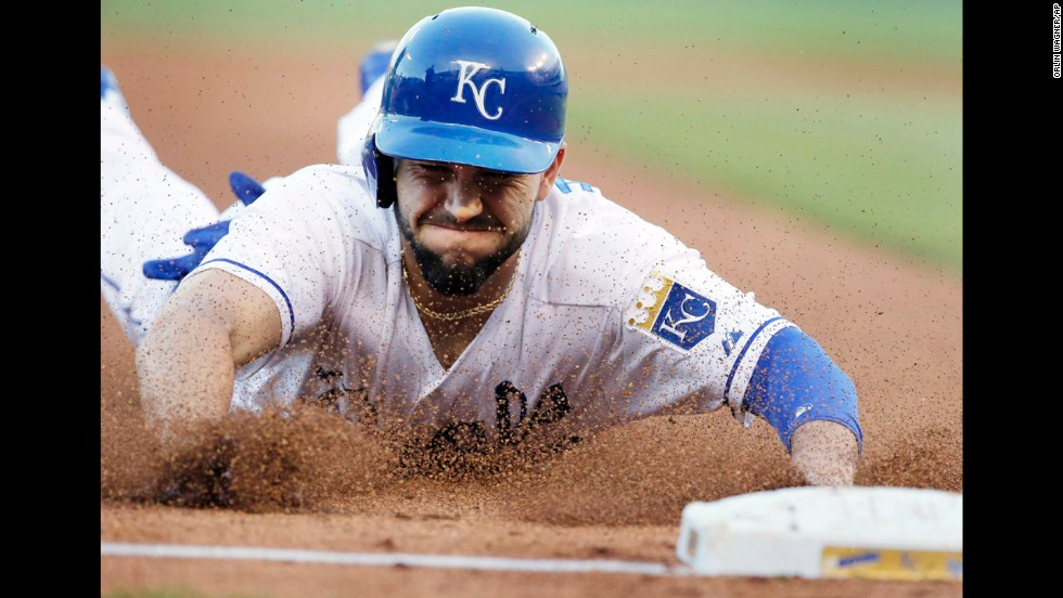 Eric Hosmer of the Kansas City Royals slides into third base during a Major League Baseball game against the Detroit Tigers on Saturday, May 3, in Kansas City, Missouri. The Tigers won the game 9-2.