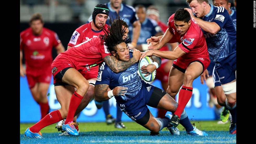 Ma'a Nonu of the Blues is tackled Friday, May 2, during a Super Rugby match against the Queensland Reds in Auckland, New Zealand. The Blues triumphed 44-14.