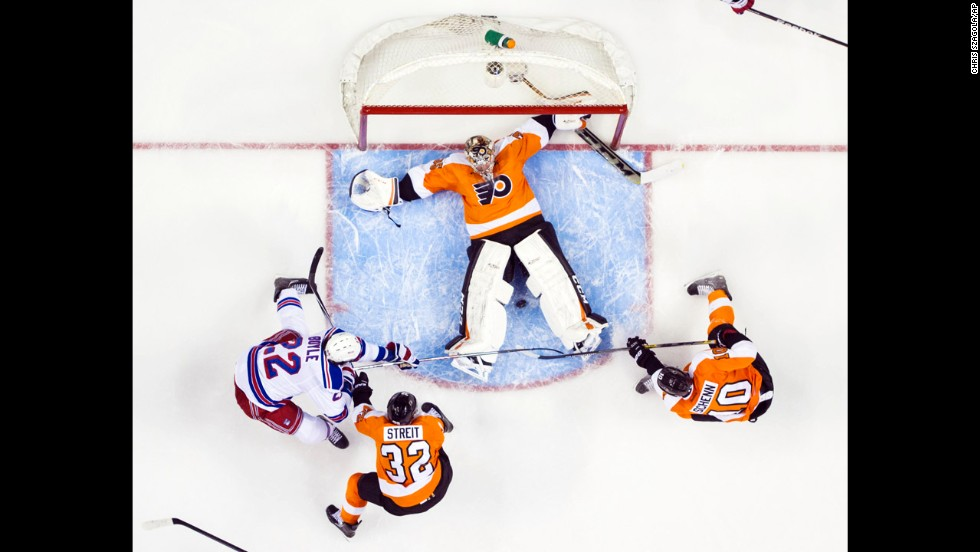 Philadelphia Flyers goalie Steve Mason tries to keep the puck between his legs during Game 6 of the NHL playoff series against the New York Rangers on Tuesday, April 29. The Flyers won the game 5-2 but lost the deciding Game 7 to end their season.