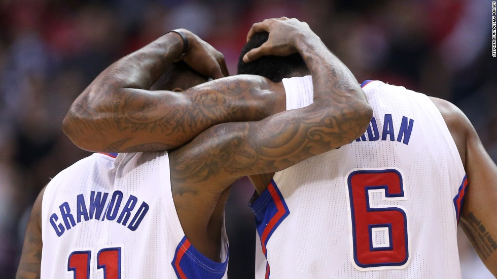 Jamal Crawford and DeAndre Jordan, two players with the NBA's Los Angeles Clippers, embrace Tuesday, April 29, during the final minute of a playoff game against the Golden State Warriors. The Clippers won the game hours after NBA Commissioner Adam Silver banned their owner, Donald Sterling, for racist remarks. The Clippers would later go on to win the series in seven games.