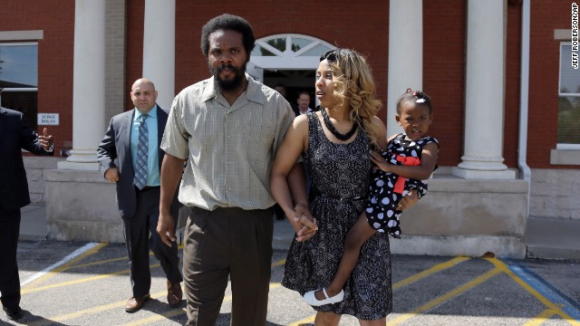 "Cornealious ""Mike"" Anderson walks out of the Mississippi County Courthouse along with his wife LaQonna Anderson, right, their daughter Nevaeh, 3, and his attorney Patrick Megaro, left, Monday, May 5, 2014, in Charleston, Mo."