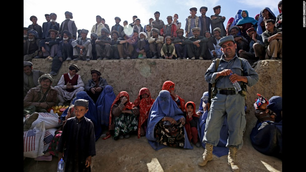 Afghan survivors wait for food donations Tuesday, May 6, near where a double landslide struck in the northeastern province of Badakhshan. More than 2,000 people were killed when a mass of rock and mud came crashing down Friday, May 2, in the village of Abi Barak.