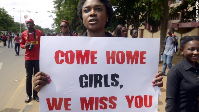A woman carries placard to press for the release of missing Chibok school girls during a rally by civil society in Lagos on May 5, 2014.